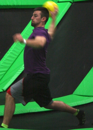 Man Playing Area Dodgeball on a Trampoline