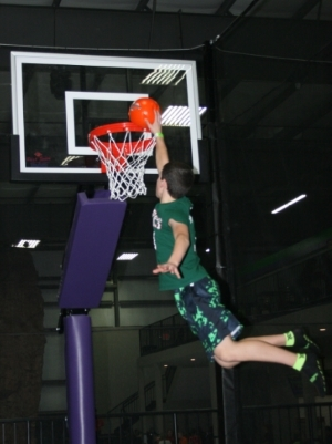 Child Dunking at Appleton Trampoline Basketball Court