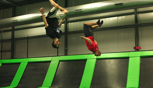 Teenagers doing flips on the trampolines