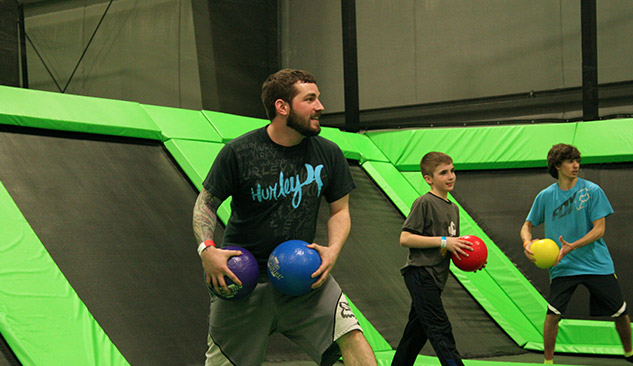 Trampoline dodgeball fun with family teams